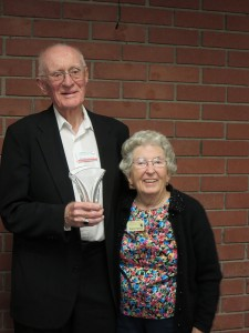 Board celebrates emeritus board member George Spindt, pictured here with his wife Evelyn, at a dinner in his honor (July 2013).